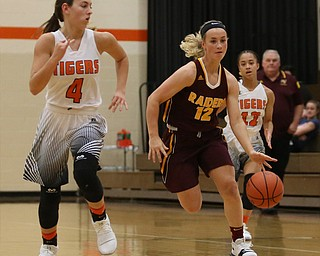 South Range's Bree Kohler (12) charges towards the net as Howland's Mackenzie Maze (4) closes in during the first quarter of the Toni Ross Spirit Foundation basketball tournament, Saturday, Nov. 25, 2017, at Howland High School in Howland. South Range won 55-51...(Nikos Frazier | The Vindicator)..