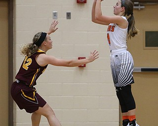 Howland's Mackenzie Maze (4) goes up for two during the first quarter against South Range in the Toni Ross Spirit Foundation basketball tournament, Saturday, Nov. 25, 2017, at Howland High School in Howland. South Range won 55-51...(Nikos Frazier | The Vindicator)..