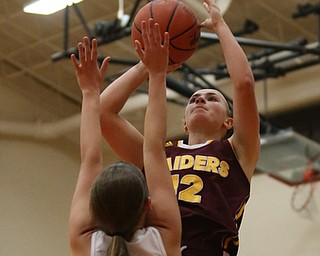 South Range's Bree Kohler (12) goes up for a layup over Howland's Mackenzie Maze (4) during the first quarter of the Toni Ross Spirit Foundation basketball tournament, Saturday, Nov. 25, 2017, at Howland High School in Howland. South Range won 55-51...(Nikos Frazier | The Vindicator)..