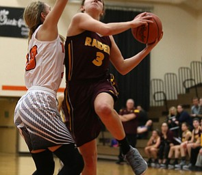 South Range's Izzy Lamparty (3) goes up for a layup against Howland's Alex Ochman (20) during the first quarter of the Toni Ross Spirit Foundation basketball tournament, Saturday, Nov. 25, 2017, at Howland High School in Howland. South Range won 55-51...(Nikos Frazier | The Vindicator)..