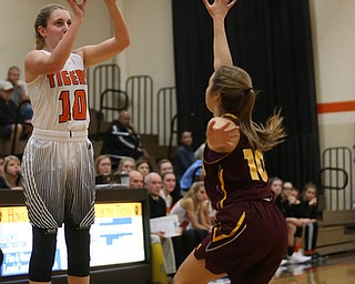 Howland's Gabby Hartzell (10) goes up for three as South Range's Ashley McKee (10) tries to block her shot during the second quarter of the Toni Ross Spirit Foundation basketball tournament, Saturday, Nov. 25, 2017, at Howland High School in Howland. South Range won 55-51...(Nikos Frazier | The Vindicator)..