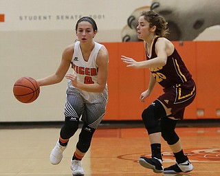 Howland's Mackenzie Maze (4) dribbles towards the basket as South Range's Brooke Sauerwein (20) tries to screen during the second quarter of the Toni Ross Spirit Foundation basketball tournament, Saturday, Nov. 25, 2017, at Howland High School in Howland. South Range won 55-51...(Nikos Frazier | The Vindicator)..