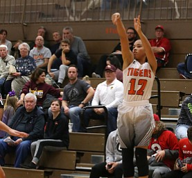 Howland's Ka'Rina Mallory (12) goes up for three during the second quarter of the Toni Ross Spirit Foundation basketball tournament, Saturday, Nov. 25, 2017, at Howland High School in Howland. South Range won 55-51...(Nikos Frazier | The Vindicator)..