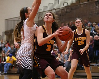South Range's Izzy Lamparty (3) looks up towards the basket before attempting a layup against Howland's Mackenzie Maze (4) during the third quarter of the Toni Ross Spirit Foundation basketball tournament, Saturday, Nov. 25, 2017, at Howland High School in Howland. South Range won 55-51...(Nikos Frazier | The Vindicator)..