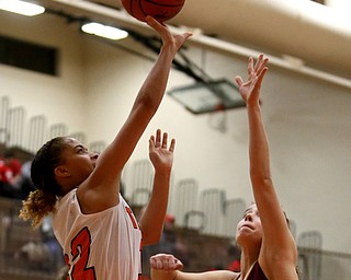 Howland's Ka'Rina Mallory (12) goes up for a layup against South Range's Brooke Sauerwein (20) during the fourth quarter of the Toni Ross Spirit Foundation basketball tournament, Saturday, Nov. 25, 2017, at Howland High School in Howland. South Range won 55-51...(Nikos Frazier | The Vindicator)..