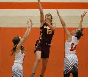 South Range's Maddi Durkin (13) hooks behind the basket for a layup during the fourth quarter of the Toni Ross Spirit Foundation basketball tournament, Saturday, Nov. 25, 2017, at Howland High School in Howland. South Range won 55-51...(Nikos Frazier | The Vindicator)..