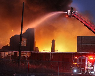 William D. Lewis The Vindicator  Firefighters from several Columbiana County departments respond to a fire at the former Salem China facilty on S. Broadway in Salem Tuesday Nov 28, 2017. Smoke from hte fire could be seen from Austintown.