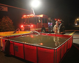 William D. Lewis The Vindicator  Firefighters from several Columbiana County departments respond to a fire at the former Salem China facilty on S. Broadway in Salem Tuesday Nov 28, 2017. They are shown here setting up portable water tanks to provide water to fight the fighter. Smoke from hte fire could be seen from Austintown.