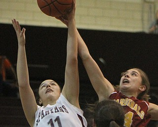 William d. Lewis the Vindicator   Boardman's Alicia Saxton(11) and Mooney's Camden Hergenrother(14) go for a rebound during 11292017 action at Boardman.