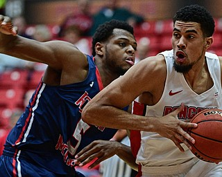 YOUNGSTOWN, OHIO - NOVEMBER 29, 2017: Youngstown State's Devin Haygood drives on Robert Morris's Malik Petteway during the first half of their game Wednesday night at Beeghley Center. Robert Morris won 81-74. DAVID DERMER | THE VINDICATOR