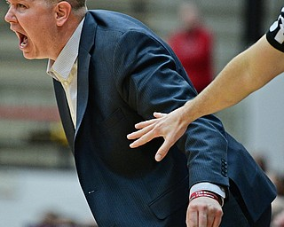 YOUNGSTOWN, OHIO - NOVEMBER 29, 2017: Youngstown State head coach Jerrod Calhoun shouts out instructions from the sideline during the second half of their game Wednesday night at Beeghley Center. Robert Morris won 81-74. DAVID DERMER | THE VINDICATOR