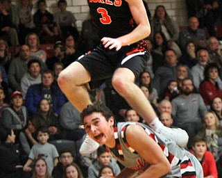 William D Lewis the vindicator Canfield's Ben Shapiro(3) keeps control of the ball as  Marlingtons Michael Huberty(3) flies over him during 11302017 action at Canfield.