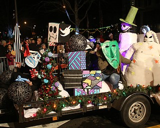 Members of the Purple Cat in a The Nightmare Before Christmas inspired float during the annual Youngstown Christmas Parade and Tree lighting, Friday, Dec. 1, 2017, in downtown Youngstown...(Nikos Frazier | The Vindicator)