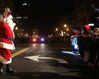 Santa arrives on Federal St. during the annual Youngstown Christmas Parade and Tree lighting, Friday, Dec. 1, 2017, in downtown Youngstown...(Nikos Frazier | The Vindicator)