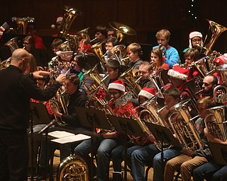 Wes O'Connor conducts the concert during a holiday craft show and third annual Tuba Christmas, Sunday, Dec. 3, 2017, at Stambaugh Auditorium in Youngstown...(Nikos Frazier   The Vindicator)
