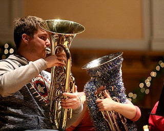 Brent Drysdale, a YSU Student, plays the euphonium  during a holiday craft show and third annual Tuba Christmas, Sunday, Dec. 3, 2017, at Stambaugh Auditorium in Youngstown...(Nikos Frazier   The Vindicator)