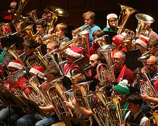 Musicians during a holiday craft show and third annual Tuba Christmas, Sunday, Dec. 3, 2017, at Stambaugh Auditorium in Youngstown...(Nikos Frazier   The Vindicator)