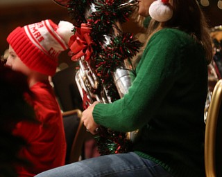 Charissa Broennle of Warren plays the baritone during a holiday craft show and third annual Tuba Christmas, Sunday, Dec. 3, 2017, at Stambaugh Auditorium in Youngstown...(Nikos Frazier   The Vindicator)