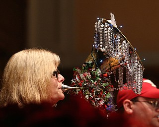 Tracy Lewis of Howland plays the baritone during a holiday craft show and third annual Tuba Christmas, Sunday, Dec. 3, 2017, at Stambaugh Auditorium in Youngstown...(Nikos Frazier   The Vindicator)