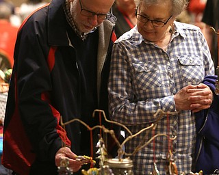Janet Formichelli and husband Art Rothenberg of Canfield look at Christmas decorations during a holiday craft show and third annual Tuba Christmas, Sunday, Dec. 3, 2017, at Stambaugh Auditorium in Youngstown...(Nikos Frazier   The Vindicator)