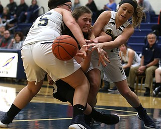 Lowellville's Angie Williams (25) and Lowellville's Maddie Warren (32) collide with Mineral Ridge's Alexa Hawkins (23) during the second quarter as Mineral Ridge High School takes on Lowellville High School, Monday, Dec. 4, 2017, at Lowellville High School in Lowellville. Mineral Ridge won 45-33...(Nikos Frazier | The Vindicator)..