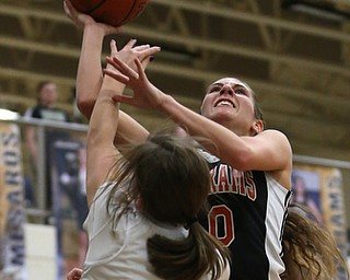 Mineral Ridge's Taryn Kolesar (10) goes up for a layup over Lowellville's Kennedy Kelly (5) during the fourth quarter as Mineral Ridge High School takes on Lowellville High School, Monday, Dec. 4, 2017, at Lowellville High School in Lowellville. Mineral Ridge won 45-33...(Nikos Frazier | The Vindicator)..