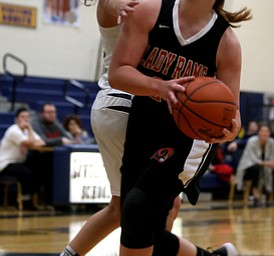 Mineral Ridge's Alexa Harkins (23) charges up for a layup during the fourth quarter as Mineral Ridge High School takes on Lowellville High School, Monday, Dec. 4, 2017, at Lowellville High School in Lowellville. Mineral Ridge won 45-33...(Nikos Frazier | The Vindicator)..