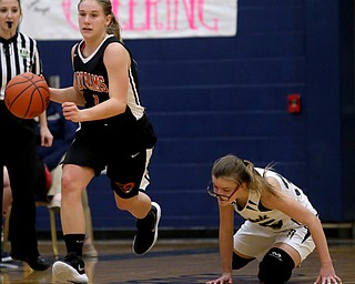 Mineral Ridge's Nevaeh Cruz (1) charges towards the net as Lowellville's Emily McGarvey (35) recovers from a collision on the court during the fourth quarter as Mineral Ridge High School takes on Lowellville High School, Monday, Dec. 4, 2017, at Lowellville High School in Lowellville. Mineral Ridge won 45-33...(Nikos Frazier | The Vindicator)..
