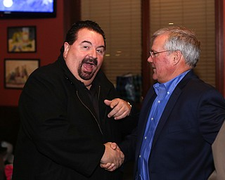 Mahoning County Commissioner Anthony Traficanti greets Boardman Police Chief Jack Nichols during a retirement party honoring Chief Nichols, Wednesday, Dec. 6, 2017, at Magic Tree Pub & Eatery in Boardman. Chief Nichols will officially retire on December 31, after having served 40 years with the Boardman Police Department...(Nikos Frazier | The Vindicator)