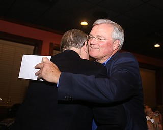 Boardman Police Chief Jack Nichols hugs Trustee Tom Costello during a retirement party honoring Boardman Police Chief Jack Nichols, Wednesday, Dec. 6, 2017, at Magic Tree Pub & Eatery in Boardman. Chief Nichols will officially retire on December 31, after having served 40 years with the Boardman Police Department...(Nikos Frazier | The Vindicator)