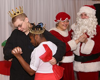 Nathan Smith and Andera West dance after being named the Snow Prince and Princess during the 13th annual Winterfest special needs dance, Wednesday, Dec. 6, 2017, at the Mahoning Country Club in Girard...(Nikos Frazier | The Vindicator)