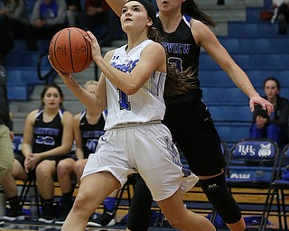 POLAND, OHIO - DECEMBER 6, 2017: Poland's Brooke Bobbey (1) drives as Lakeview's Annie Pavlansky (33)  defends during the 2nd qtr. at Poland High School.  MICHAEL G. TAYLOR | THE VINDICATOR