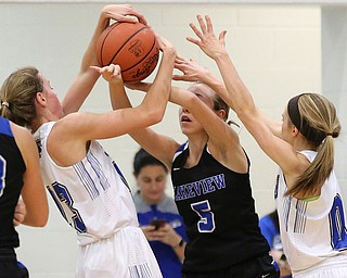 POLAND, OHIO - DECEMBER 6, 2017: Poland's Maggies Sebest (23) (left) and Poland's Bella Gajdosl (0) defend against Lakeview's Christine Innocenzi (5) during the 2nd qtr. at Poland High School.  MICHAEL G. TAYLOR | THE VINDICATOR