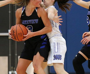 POLAND, OHIO - DECEMBER 6, 2017: Poland's Marlie McConnell (20) defend against Lakeview's Lindsay Carnahan (2) during the 3rd qtr. at Poland High School.  MICHAEL G. TAYLOR | THE VINDICATOR
