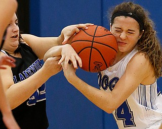 POLAND, OHIO - DECEMBER 6, 2017: Poland's Gabby Romano (1) steals the ball from Lakeview's Laura Garvin (32) during the 3rd qtr. at Poland High School.  MICHAEL G. TAYLOR | THE VINDICATOR