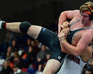 AUSTINTOWN, OHIO - DECEMBER 21, 2017: Howland's Ray Kaso is taken down to the mat by Boardman's Michael O'Horo during their 170lb bout, Thursday night at Austintown Fitch High School. DAVID DERMER | THE VINDICATOR
