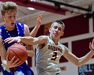 CANFIELD, OHIO - DECEMBER 22, 2017: Western Reserve's Kade Hilles grabs a rebound away from South Range's Ben Irons during the first half of their game on Friday night at South Range High School. DAVID DERMER | THE VINDICATOR