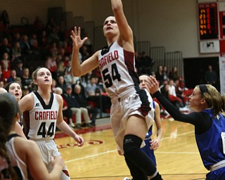 Canfield guard Serena Sammarone (54) goes up for a layup in the first quarter of an AAC high school basketball game, Friday, Dec. 23, 2017, in Canfield. Canfield won 45-34...(Nikos Frazier | The Vindicator)