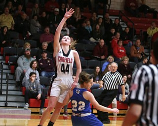 Canfield guard Grace Mangapora (44) goes up for a layup as Poland guard Kat Partika (22) falls to the court in the first quarter of an AAC high school basketball game, Friday, Dec. 23, 2017, in Canfield. Canfield won 45-34...(Nikos Frazier | The Vindicator)