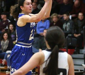 Poland guard Jackie Grisdale (21) goes up for three in the second quarter of an AAC high school basketball game, Friday, Dec. 23, 2017, in Canfield. Canfield won 45-34...(Nikos Frazier | The Vindicator)