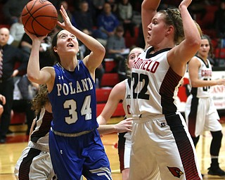 Poland guard Gabby Romano (34) goes up for a layup as Canfield post Chloe Kalina (22) goes up to block the shot in the second quarter of an AAC high school basketball game, Friday, Dec. 23, 2017, in Canfield. Canfield won 45-34...(Nikos Frazier | The Vindicator)