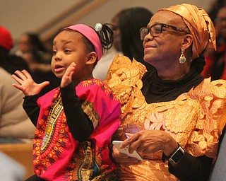 William D. Lewis  The Vindicator Janet Johnson and her grandughter Malayah Shavers, 3, both of Youngstown enjoy the first night of Kwanzaa at New Bethel Baptist Church in Youngstown 12-26-17.