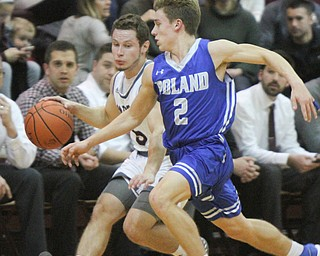 William D. Lewis The Vindicator Poland's Mike Diaz(2) tries to steal the ball from Boardman's Mike Melewski(5) a during 12-27-17 action at Boardman.