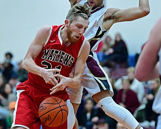 LIBERTY, OHIO - DECEMBER 27, 2017: Mathews Tanner Hunt bobbles the ball while being pressured by Liberty's Kevin Code during the first half of their game on Wednesday night at Liberty High School. DAVID DERMER | THE VINDICATOR