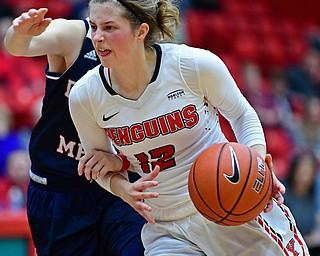 YOUNGSTOWN, OHIO - DECEMBER 28, 2017: Youngstown State's Chelsea Olson drives on Nicole Urbanick during the first half of their game on Thursday night at Beeghly Center. Youngstown State won 76-59. DAVID DERMER | THE VINDICATOR