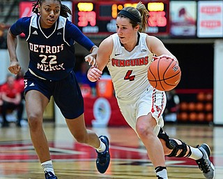 YOUNGSTOWN, OHIO - DECEMBER 28, 2017: Youngstown State's Nikki Arbanas drives on Detroit's Zoey Oatis during the first half of their game on Thursday night at Beeghly Center. Youngstown State won 76-59. DAVID DERMER | THE VINDICATOR