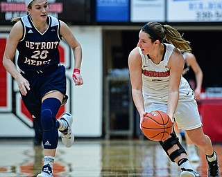 YOUNGSTOWN, OHIO - DECEMBER 28, 2017: Youngstown State's Nikki Arbanas gains possession of the ball after taking it away from Detroit's Nicole Urbanick during the second half of their game on Thursday night at Beeghly Center. Youngstown State won 76-59. DAVID DERMER | THE VINDICATOR