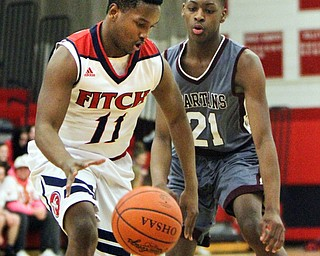 William D. Lewis The Vindicator  Fitch'sEmanuel Dawkins(11) drives around Boardman's Che Trevena(21) during 12-29-17 action at Fitch.