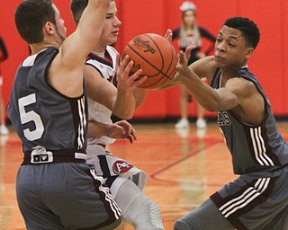 William D. Lewis The Vindicator  Fitch'sBlake Baker(3) is hemmed in by Boardman's Mike Melewski(5) and Ryan Archey(2)during 12-29-17 action at Fitch.