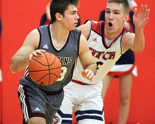 William D. Lewis The Vindicator  Boardman's  Dom Stilliano(33) drives around Fitch;sCole Constance(5) during 12-29-17 action at Fitch.